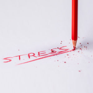A red pencil cracks under the stress of too much pressure